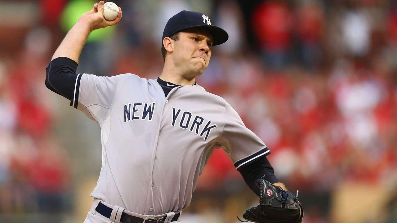Starter David Phelps of the Yankees pitches against