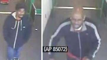 Police have released surveillance footage of two men