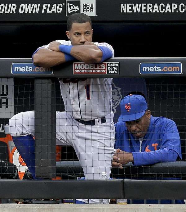 The Mets' Chris Young (1) watches from the