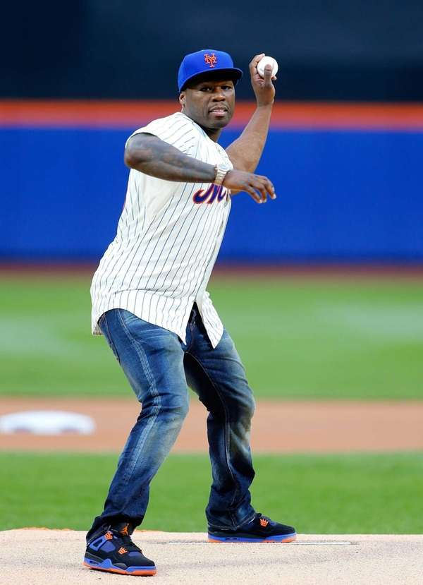 Rap artist 50 Cent throws out the ceremonial