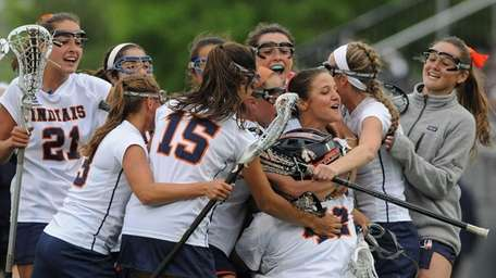Manhasset teammates celebrate after their 15-8 win over