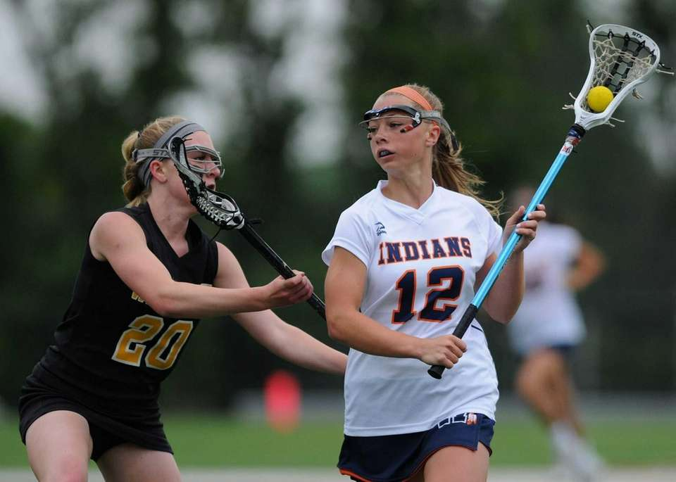 Manhasset's Lindsey Ronbeck, right, gets pressured by Wantagh's
