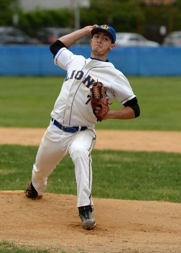 West Islip's Nick Arnold delivers a strike during