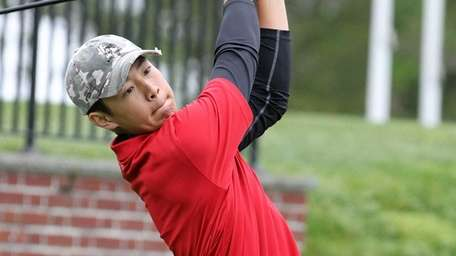 Syosset's Willis Huynh tees off during the Long
