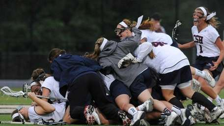 Cold Spring Harbor teammates celebrate after their 13-9