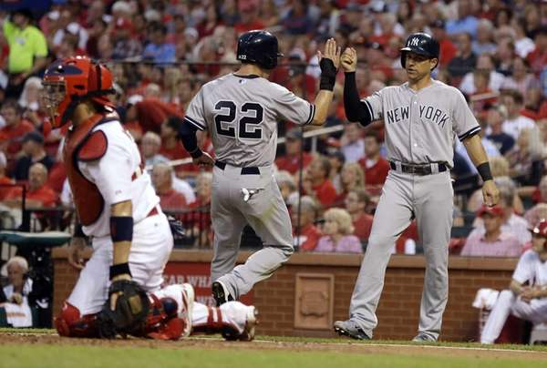 Yankees' Jacoby Ellsbury and Brian Roberts, right, celebrate