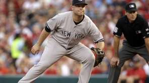 Yankees' Brian McCann takes up his position at