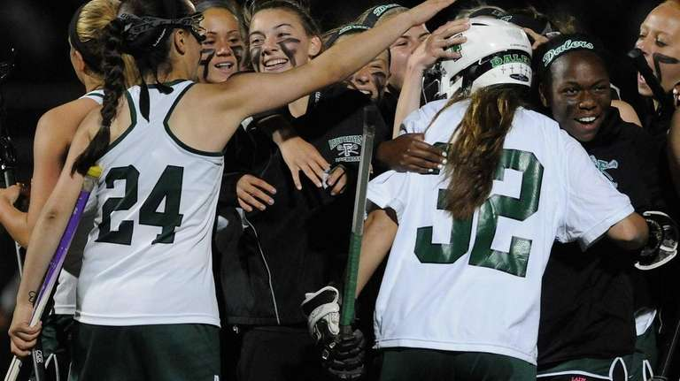 Farmingdale teammates celebrate after their 12-7 win over