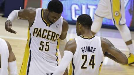 Indiana Pacers' Roy Hibbert and Paul George celebrate