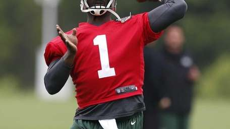 Jets quarterback Michael Vick throws a pass during