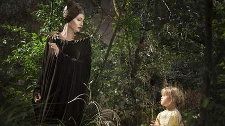 Maleficent (Angelina Jolie) and Young Aurora (her daughter