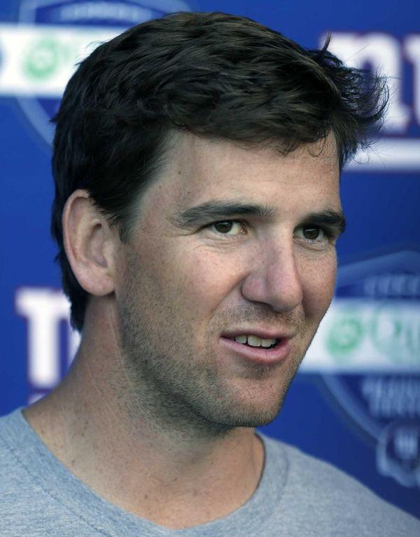 Giants quarterback Eli Manning talks to the media