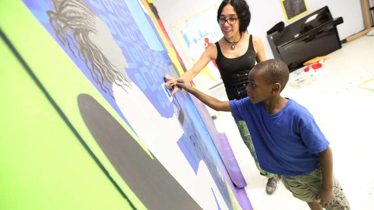 Community artist Lucienne Pereira and Nazier Grant, 7,