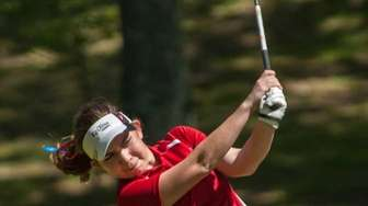 Smithtown East's Peyton Greco tees off during the
