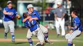 Division pitcher Chris Reilly celebrates with catcher Mark