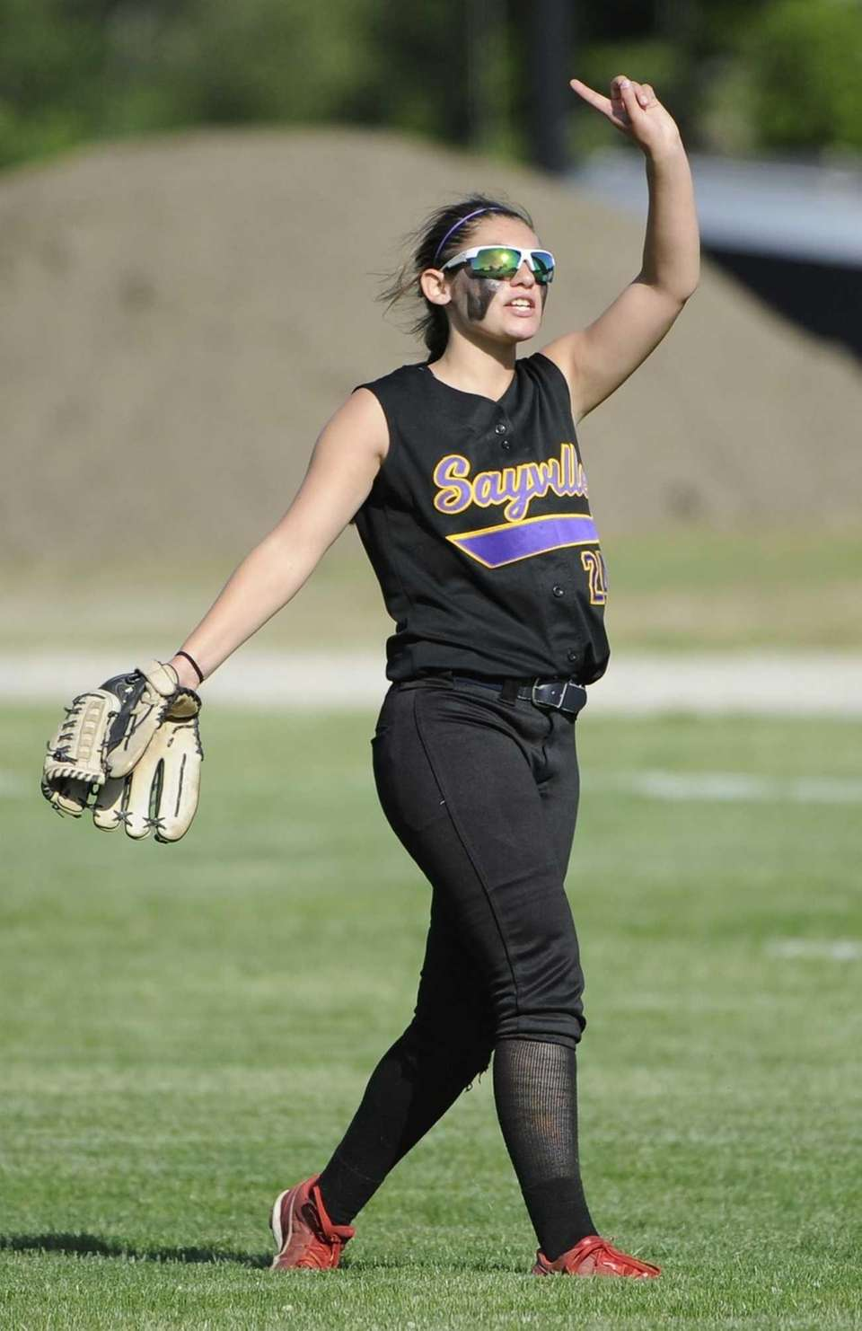 Sayville's Sabrina Bencivenga signals one out in the