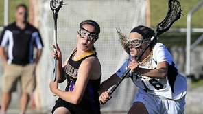 Sayville's Kaitlyn Wandelt drives against Eastport-South Manor's Delaney
