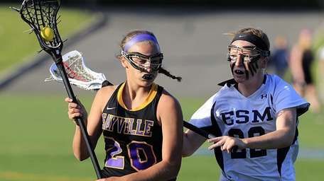 Sayville's Kelly Marra drives against Eastport-South Manor's Rebecca