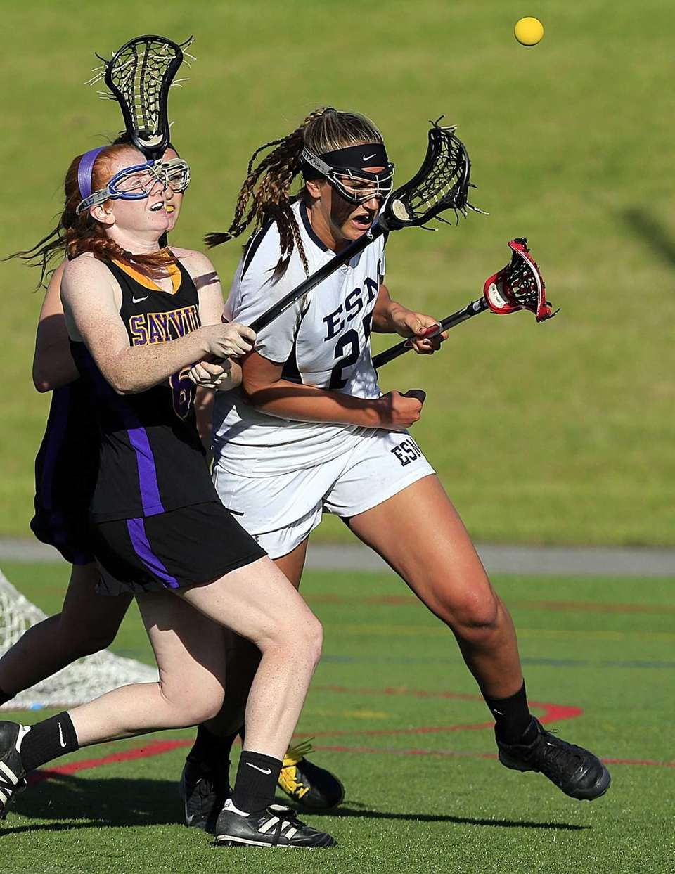 Sayville's Julianne Johnson stick checks the ball away