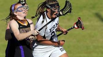 Sayville's Julianne Johnson stick checks the ball away
