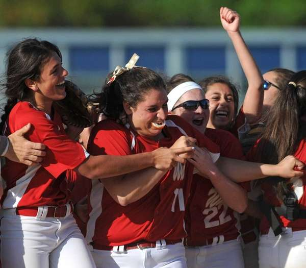 Half Hollow Hills West teammates celebrate with pitcher