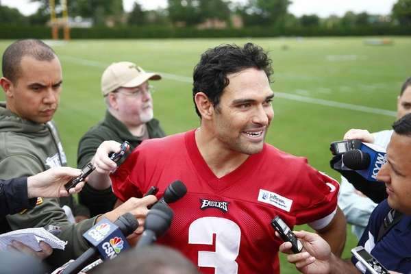 Philadelphia Eagles quarterback Mark Sanchez speaks with members