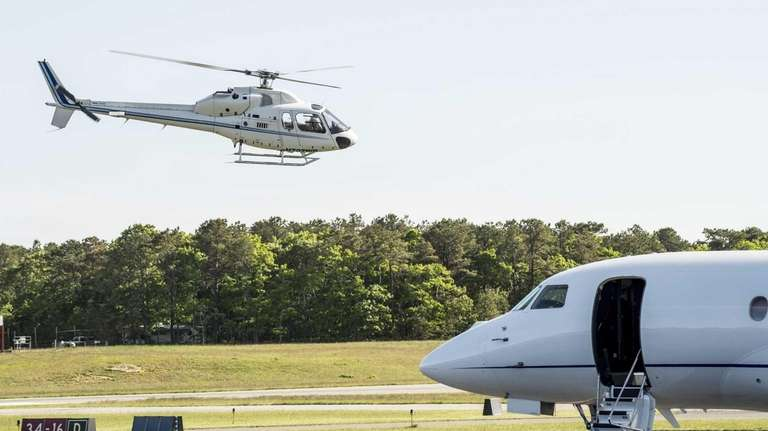 A helicopter takes off from East Hampton Airport