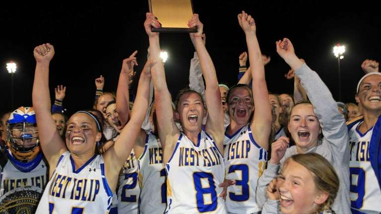 The West Islip girls lacrosse team holds up