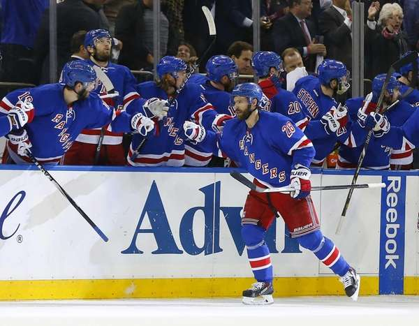 Dominic Moore of the Rangers celebrates his second-period