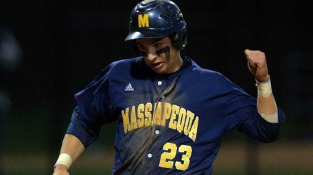 Massapequa's Matt Diesel reacts as he scores a