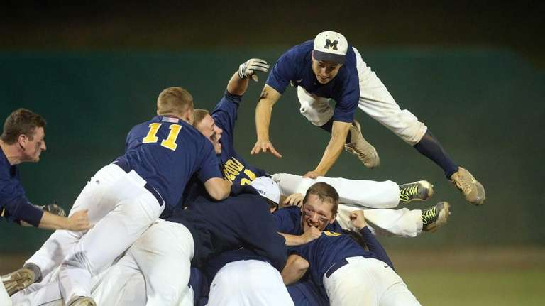 Massapequa celebrates after defeating Oceanside during the Nassau