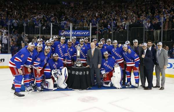 The Rangers pose with the Prince of Wales trophy after defeating the Montreal Canadiens in Game 6 of the Eastern Conference finals at Madison Square Garden on Thursday, May 29, 2014.
