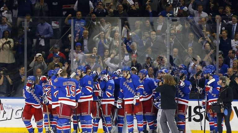 The Rangers celebrate after defeating the Montreal Canadiens