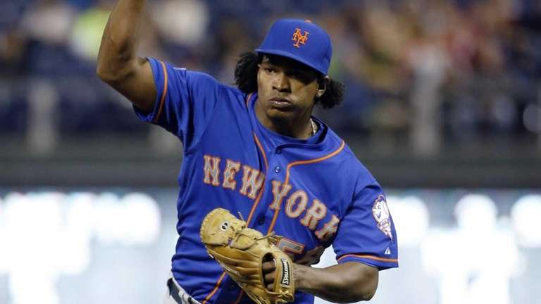 Mets pitcher Jenrry Mejia reacts after striking out