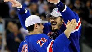 Chris Kreider of the Rangers hugs teammate Brian