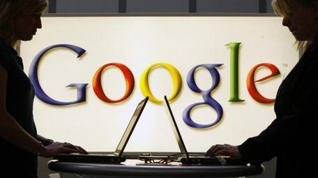 Exhibitors of the Google company work on laptop