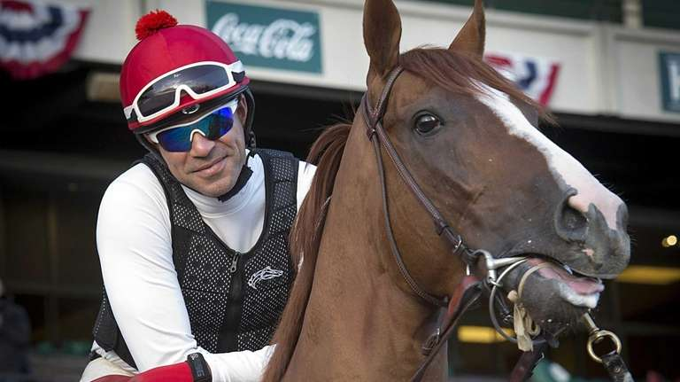 Triple Crown contestant California Chrome with exercise rider