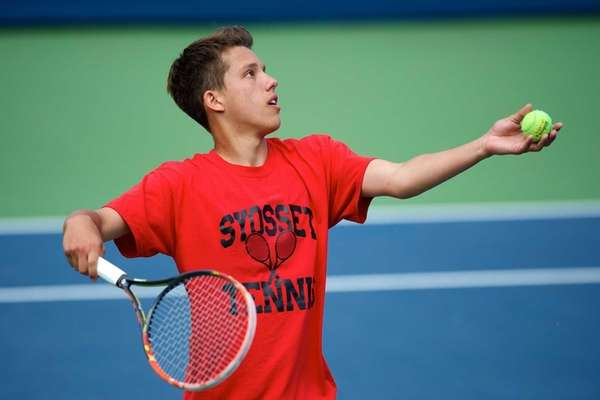 Dylan Granat of Syosset prepares to serve in