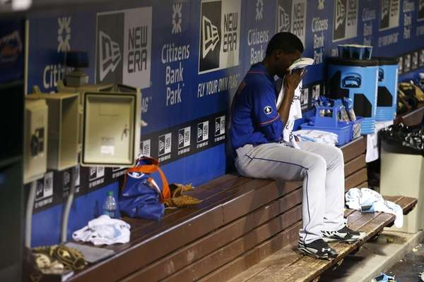 Mets starting pitcher Rafael Montero wipes his face