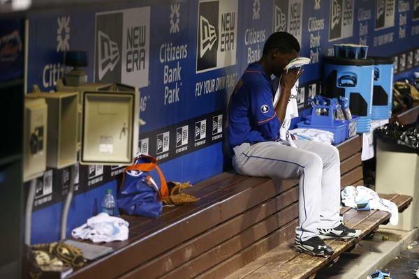 Mets starting pitcher Rafael Montero wipes his face