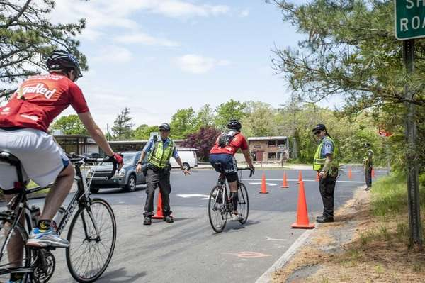 East Hampton Town police traffic control officers direct