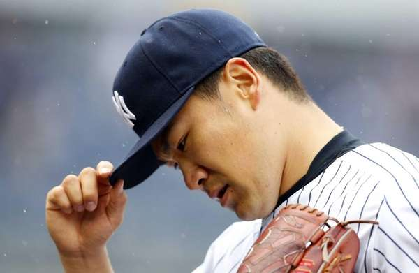 Masahiro Tanaka of the Yankees walks to the