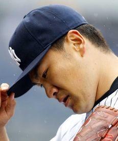 Masahiro Tanaka of the Yankees walks to the