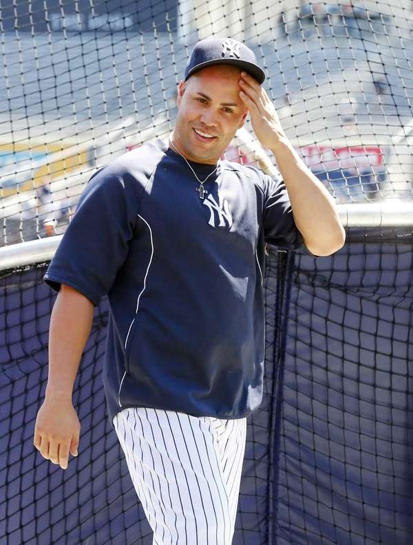 Carlos Beltran of the Yankees looks on during