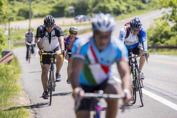 Ride to Montauk cyclists climb a hill as