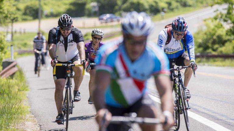 Ride to Montauk cyclists climb a hill as