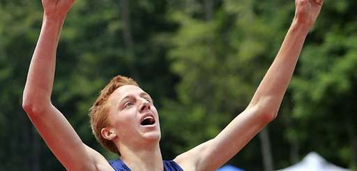 Shoreham-Wading River's Keith Steinbraecher celebrates winning the boys