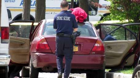 Nassau County crime scene detectives along with homicide