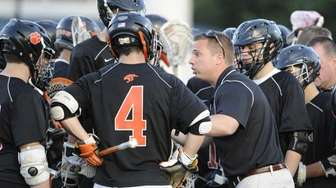 Babylon head coach John Greaney directs his team