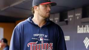 Phil Hughes of the Minnesota Twins looks on